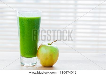 Fresh juice from green vegetables and fruits. Healthy organic and refreshing drink full of vitamins. Full glass with apple