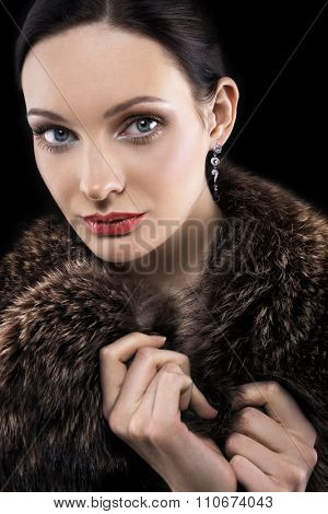 Portrait of beautiful woman in fur coat