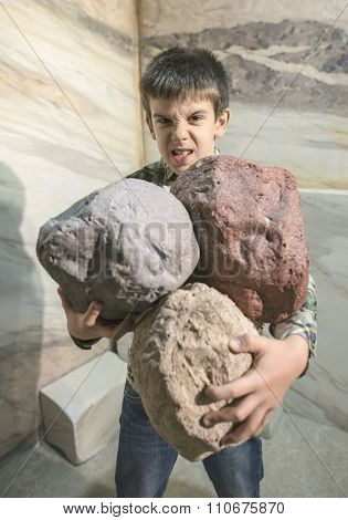 Strong Child Holds Heavy Stones