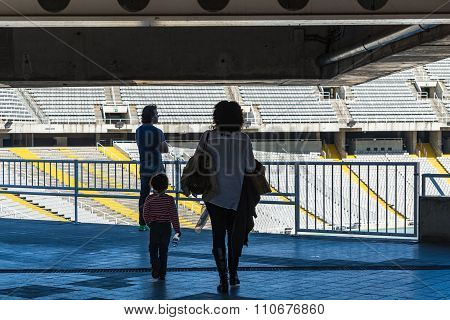 BARCELONA, SPAIN - MARCH 27, 2015: Olympic National Stadium Lewis Companys  Family man woman child visiting bowl empty tribunes on sport arena built in 1927 and located in the Anella Olimpica Montjuic