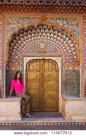 Young Woman Sitting At Lotus Gate In Pitam Niwas Chowk, Jaipur City Palace, Rajasthan, India