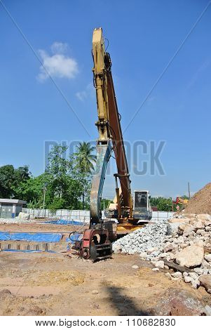 Steel sheet pile cofferdam machine at the construction site.
