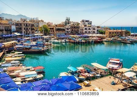 Kyrenia (Girne) CYPRUS - JULY 5: Historic harbour and the old town on July 5 2015. Kyrenia harbor is currently a famous tourist resort.