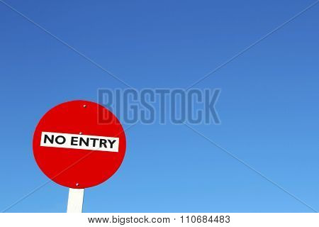 No entry sign in front of blue