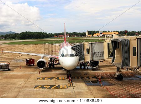 Passenger Airplane On Land Boarding For Departure