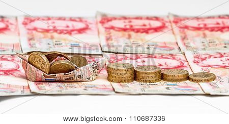 Money pound sterling boat concept white background