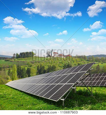 Solar panels in spring landscape.