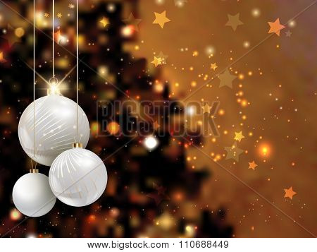 Christmas baubles on a defocussed tree background