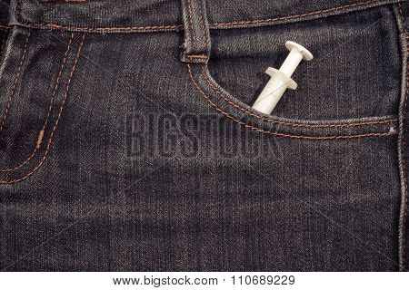 Sapric In The Front Pocket Of Jeans.  Background.