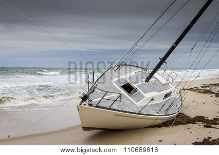 Sailboat Grounded On A Florida Beach