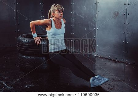 athlete woman doing push-ups on bench training triceps workout concept fitness, sport.