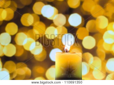Candle Light In Yellow Bokeh Background