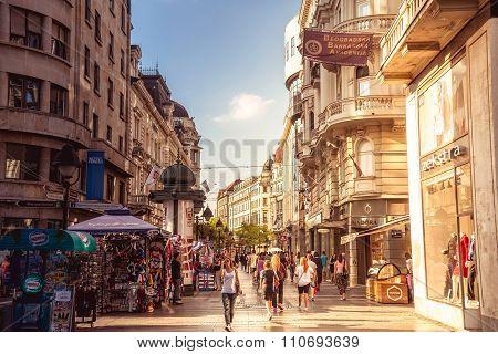BELGRADE SERBIA - SEPTEMBER 23: Knez Mihailova Street on September 23 2015 in Belgrade Serbia. Street is the main shopping mile of Belgrade. Filtered photo with warm summer lighting.