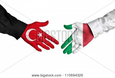 Turkey and Italy leaders shaking hands on a deal agreement