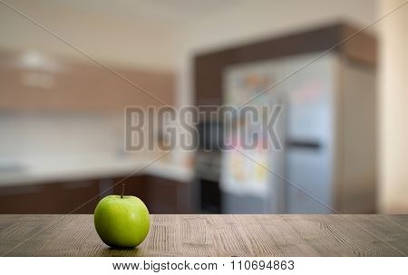 green apple on old wooden table in the bedroom
