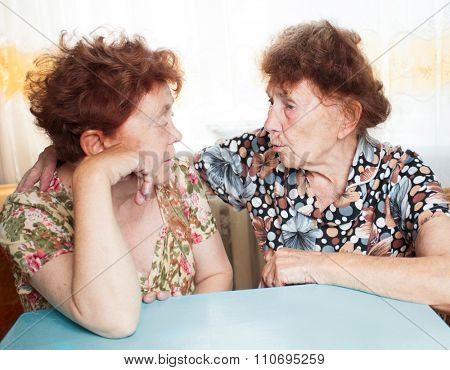Two seniors. Old women talking. Friendship elderly