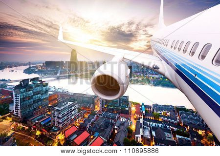 view of skycrape and cityscape from plane under sun shining