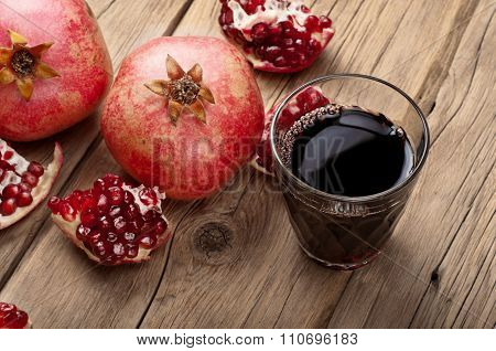 Glass Of Pomegranate Juice With Slices Of Pomegranate