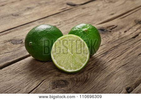 Fresh Limes On Wooden Surface