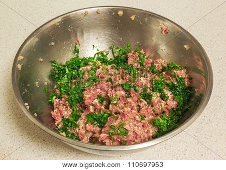 Fresh Mixed Minced Pork Beef  With Fresh Herbs In A Stainless Bowl