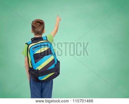 childhood, school, education and people concept - happy smiling student boy with school bag over green school chalk board background