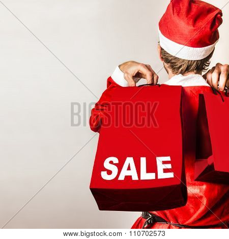 Santa Helper With Gifts At Christmas Shopping Sale