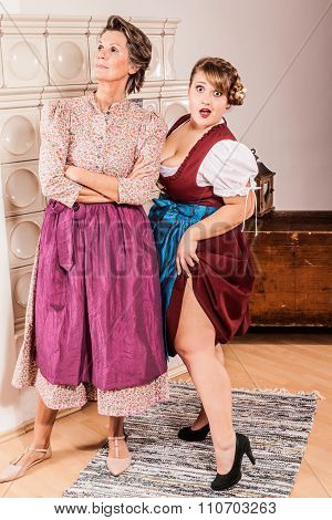 Funny two generations of two women in dirndl