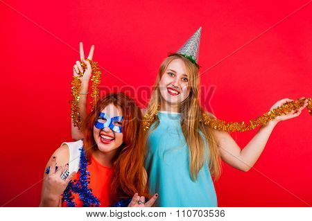 Young nice girls have fun on a party