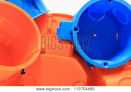 Heap Of Orange And Blue Electrical Boxes