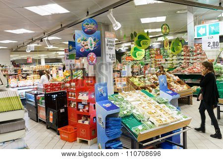 GENEVA, SWITZERLAND - SEPTEMBER 15, 2014: interior of Migros supermarket. Migros is Switzerland's largest retail company, its largest supermarket chain and largest employer