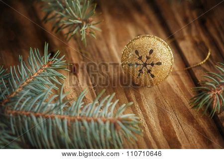 Gold Metal Jingle Bell With Snowflake On Wooden Table. Christmas