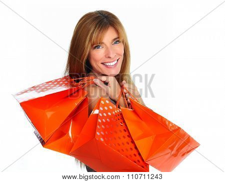 Shopping woman with paper bags isolated over white background.