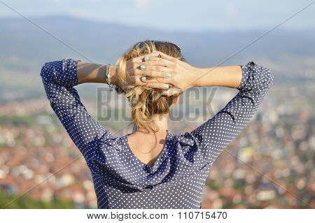 Girl Facing The Cityview From Mountain Viewpoint