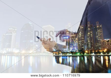Double Exposure Of City And Business Man Using Digital Smartphone