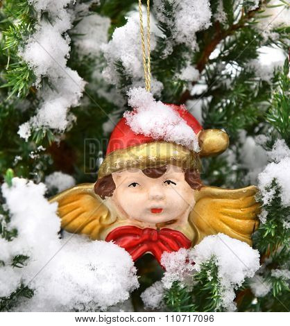 Christmas tree closeup angel red snowcovered decoration