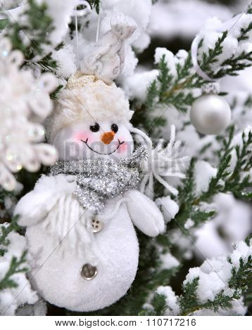 Christmas tree closeup snowcovered snowflake snowman decoration