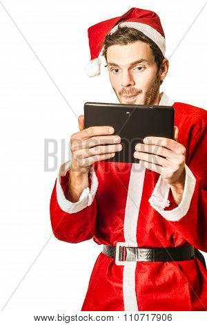 Santa Claus Watching Christmas Movies On Tablet