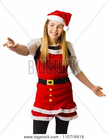 Young Woman In Santa Costume Pointing To Ad Space
