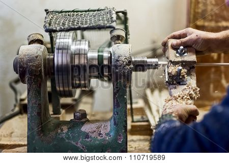 Worker Hands Using Woodturning Lathe Tool And Other Industry Tools