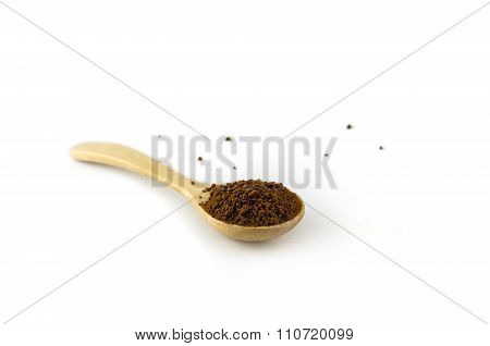 wooden spoon (teaspoon) with ground coffee powder isolated in white backgroundwooden spoon (teaspoon