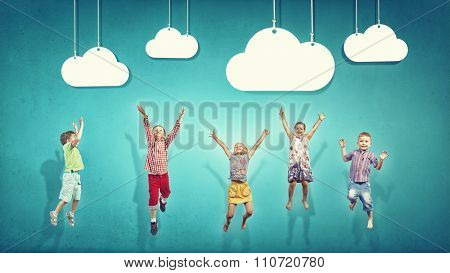 Group of children jumping high joyfully on colorful background