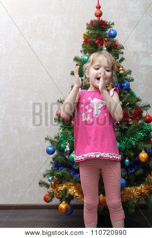 Joyful Little Girl Claps Her Hands Near Christmas Tree