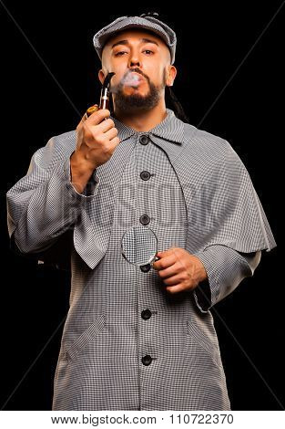 Sherlock Holmes with pipe and magnifying glass on balck background