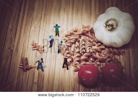 Miniature People Collect Ingredients To Cook Pasta. Color Tone Tuned.