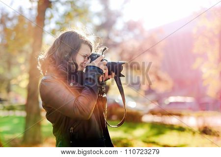 Professional Woman Photographer Taking Outdoor Portraits With camera