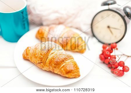 Croissant And Coffee As Breakfast In Bed On An Early Sunday Morning