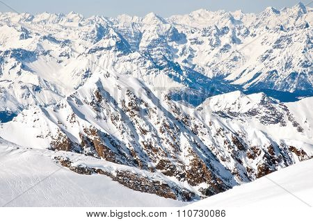 Slopes On A Skiing Resort In The Alps With Mountains Background