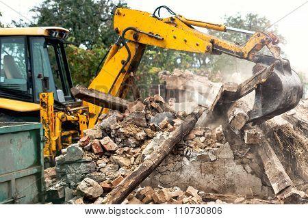 Industrial Excavator And Bulldozer Loading Debris And Demolition