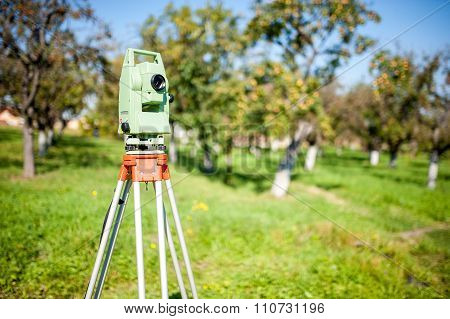 Total Station Surveying And Measuring Engineering Equipment At Work in forest