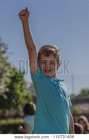 Boy Raising His Arm